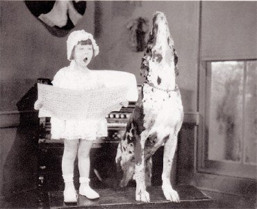 little-girl-singing-with-dog-1920-photo-postcard_230446051989
